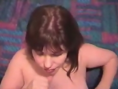 Aged wife strokes man's penis, seizing it with her hands and takes plentiful cumshot on her face.