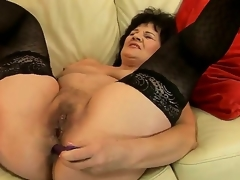 Enchanting granny Helena May is getting her cunt and anal tunnel gratified with sex toys simultaneously