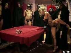 Devon and Jordan Ash join a secret cult where all the members wear masks and indulge in orgies. It turns out that their hubbies are there as well, witnessing 'em get fucked!