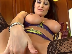 This French mamma with huge tits is a real sex freak! That babe looks gorgeous in her sexy underware and her pussy is already soaking wet. After playing with herself she goes down on a throbbing cock.