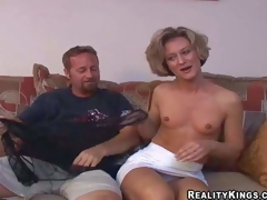Sexy slim mature brunette milf with small tits and fit body in short white petticoat and undies has enjoyment with her filthy neighbour and takes on his beefy dong in living room
