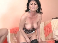 Young men fuck slutty older babe in threesome