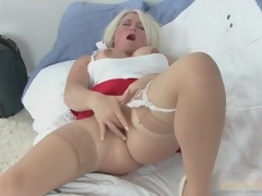 Solo golden-haired mom in skirt and nylons masturbates