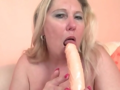 Chubby blonde mature copulates her cunt with a toy