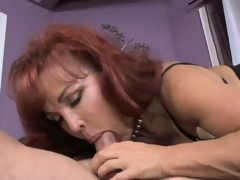 Aged redheaded mother in law receives a lusty pussy licking from her new son