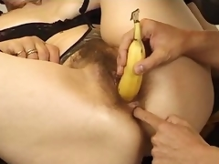 Mature takes banana and his dong in her pussy